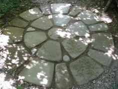 Finished Medallion of soil cement blocks - love the dappled sunlight, and the 'fossil' fern leaves