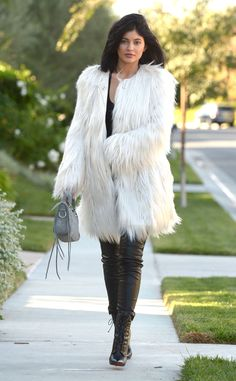 Bundled Up from Kylie Jenner's Street Style  The youngest Kardashian star opts for a white faux fur Guess coat and a pair of black Marciano leather leggings.