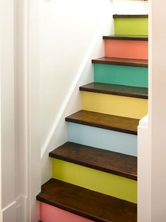 Colorful Staircase for basement stairs, a GREAT idea! Ascend and descend in style on a statement-making staircase. Try one of these ideas for turning your staircase into something special. Painted Stair Risers, Painted Staircases, Spiral Staircases, Basement Stairs, House Stairs, Painting Laminate, Stair Decor, Staircase Decoration, Stairway Decorating