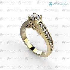 Anillo de compromiso de 14 o 18 kilates en oro amarillo, con diamante central y en el cuerpo.
