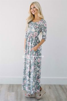 You almost feel guilty wearing this dress because you'll think you never changed out of your pj's that day, that's how soft it is! This light pink maxi dress features a pretty pink  floral print, has half sleeves, elastic babydoll waist and front pockets.