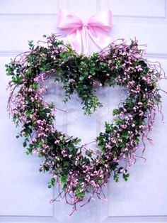 A pretty heart wreath filled with delicate pink blossoms!