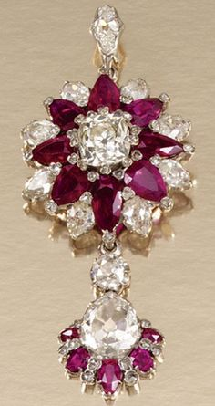 RUBY AND DIAMOND BROOCH/PENDANT, LATE 19TH CENTURY Designed as a cluster centring on a cushion-shaped diamond within surrounds of pear-shaped rubies and diamonds, further accented with rose-cut stones, suspending a ruby and diamond-set drop embellished with a principal pear-shaped diamond, detachable drop and pendant fitting, later detachable brooch fitting.