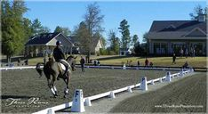 Planned equestrian community riding arena - clubhouse in background.