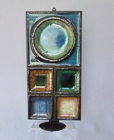 """A wall mountable candle sconce made from a heavy stoneware tile in thick glassy glazes mounted into a metal holder. Designed by Konrad Galaaen for Porsgrund in the 1950-60's. The top tile measures 6"""""""