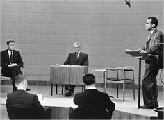 "Wegner's ""round chair"": The presidential debate 1960. John F Kennedy seated left, the Round chair and Richard Nixon, at the lectern."