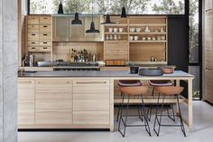 The kitchen area's pendant lights are among very few in the house – most are recessed into the concrete ceilings.