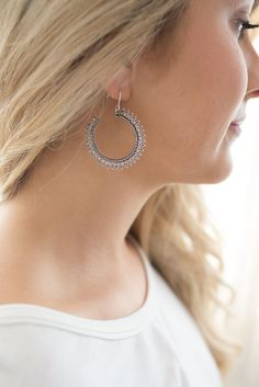 Shop our Textured Hoop Earrings in Silver. Pair with a blouse, skinny jeans, and booties for a chic look. Always free shipping on all US orders.