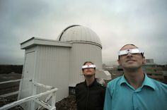 University of Waterloo students Robert Henderson and Carolyn Augusta wear protective glasses that will be available to participants in the physics department's transit of Venus public viewing on Tuesday, June 5. The glasses allow the user to look at the sun without hurting their eyes.