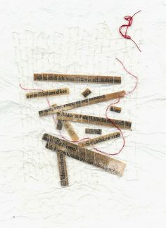 word fragments | leftover words and phrases from a fairy tale page; sewn into waxed paper | Ines Seidel