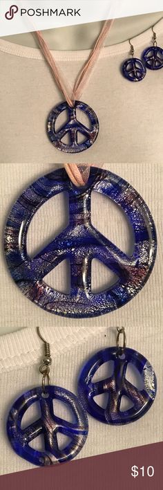 Murano Glass Necklace Peace Sign and Earrings This is a matching set of Murano Glass Peace Sign necklace and earrings.  Mixture of colors including cobalt blue, silver and a light rose.  Necklace is on a light rose organza necklace with lobster claw clasp. Jewelry Necklaces