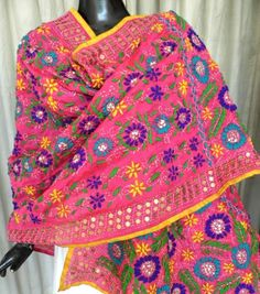 This beautiful phulkari work dupatta on handloom chanderi fabric has been hand embroidered with wool thread and sequins. A graceful and stunning accessory for your evenings out. Size: 90 in x 33 in Care: Dry Clean Only - See more at: http://giftpiper.com/HandembroideredPhulkariWorkChanderiDupatta-Pink-id-527142.html#sthash.JLsdakNa.dpuf