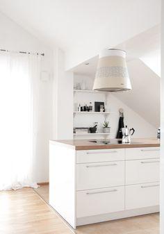white kitchen with a kitchen island