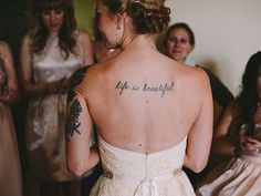 23 Beautiful Brides Who Showed Off Their Tattoos With Pride