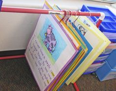 I love this idea of glueing my rhyme charts to hangers for storage and display.