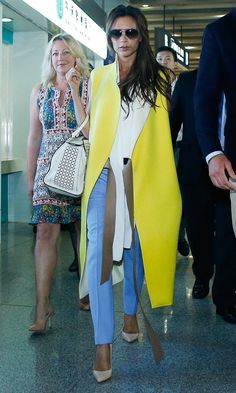 Victoria Beckham In Victoria Beckham sleeveless yellow coat out in China instyle.co.uk