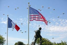 Skies filled: Paratroopers are dropped near the Normandy village of Sainte Mere Eglise, we...