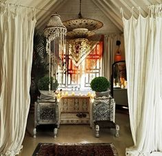 Hang curtains like this in front of bay window, with tie backs.
