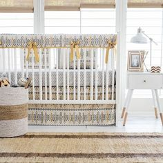 This Aztec crib rail cover  is darling! This Aztec baby bedding is from our Navajo in Gold Crib Collection !