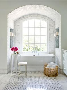 Slipper Tub Surrounded by Marble in an Elegant, Traditional Bathroom