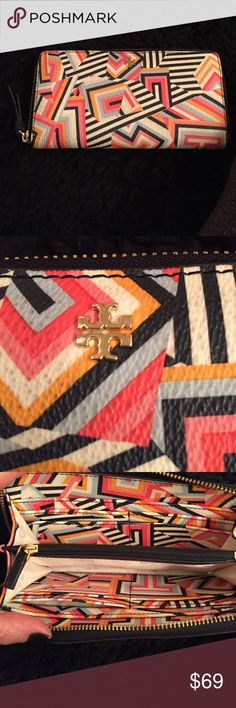 Tory Burch wallet with zipper Fun, bright and colorful Tory Burch wallet. 8 credit card slots, two pockets for bills and other  papers,  and zippered coin compartment on inside. Zipper closure. In gently used excellent condition. No signs of wear other than some darkening on the outer leather. Because of the colorful design and texture of wallet it doesn't take away from the beauty of the wallet but my price reflects this. Awesome wallet!!! Tory Burch Bags Wallets