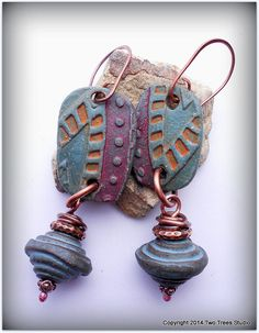 Antiqued copper wire, hammered copper beads, and some of my favorite beads by clay artist Barbara Hanselman combine to make earrings that are ethnic, earthy, colorful--and unabashedly beautiful.  By Two Trees Studio, $32.00.
