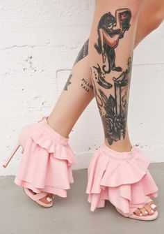Privileged Georgina Ruffled Heels cuz ya came to slay, bb. These amazing heels feature a smoooth baby pink vegan suede construction, sky high heels, open toe, tiered voluminous ruffles cascading down from the ankle, and zip back closure.