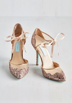 More power to the style maven who declares every day a day to sparkle! In these sassy stilettos by Betsey Johnson, said fashionista will flaunt cool beige mesh inlays, ribbon ties at the ankles, and a glittery burst of gold, silver, and soft pink hues whenever the spirit moves her. Brilliant!
