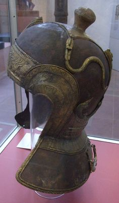 A beautiful 3rd century cavalry helmet was found at Heddernheim in Germany. The helmet is of iron, with beautifully embossed and engraved bronze skinning