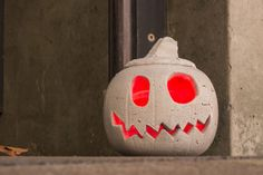 DIY Concrete Jack-O'-Lantern.. uses ShapeCrete and a plastic pumpkin as a mold.