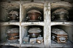 excavation of crypt interior - Recoleta Cemetery, Buenos Aires. The one in the lower middle is the one that stands out to me..little boxes of joy that budded on earth, but bloomed in heaven ♥     Copyright 2010 Robert Moran Photography