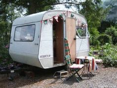 love tiny travel trailers- I want to park one in my yard so I can go hide from the kids. Mommy's time out trailer.  Oh yes.