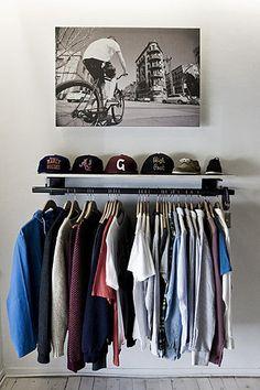 open concept clothes hanger/closet. nice. i love the hat rack.
