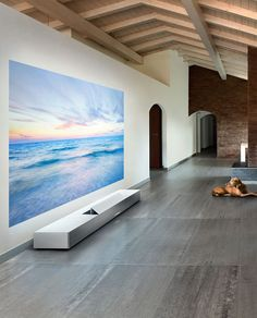 10 High-Tech Gadgets You Need in Your Bedroom via Brit + Co. | Sony Ultra Short Throw Projector: This Sony projector allows you to turn your wall (or ceiling!) into a life-sized window or movie theater. And, if you're short on space, this projector is perfect for you as it sits just seven inches from the wall.