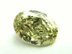 1.68 ct. Fancy Grayish Greenish Yellow, oval brilliant, SI1.