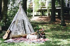 Such a pretty boho inspired lounge set up complete with teepee and all!