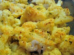 Roasted Garlic and Parmesan Cauliflower: 1 head cauliflower, separated into florets, 2 tablespoons garlic, finely chopped, 3 tablespoons  extra virgin olive oil, 1/4 cup grated Parmesan cheese, 1/4 cup Panko bread crumbs, salt and pepper to taste.