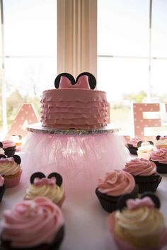 Pretty pink cake at a Minnie Mouse baby shower  party! See more party planning ideas at CatchMyParty.com!