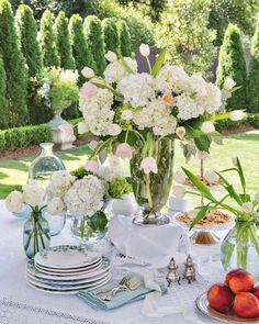Bring the resplendence of your garden to the table. Myriad arrangements of white hydrangeas, pale pink tulips, and snowy ranunculus reign on this alfresco tablescape featured in our May/June 2020 issue. Southern Ladies, Southern Style, Star Of Bethlehem, Pink Tulips, Al Fresco Dining, Spring Blooms, Easter Table, Tablescapes, Floral Arrangements
