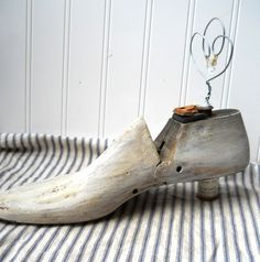 Upcycled shoe form photo display