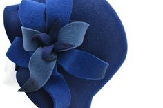 Hannah -- Stylish and colorful wool felt cloche with blooming flower embellishment.