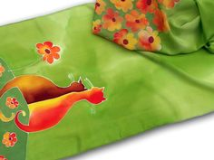 Hand painted silk scarf with orange cats & flowers in green. by SilkAgathe on Etsy https://www.etsy.com/listing/263037919/hand-painted-silk-scarf-with-orange-cats