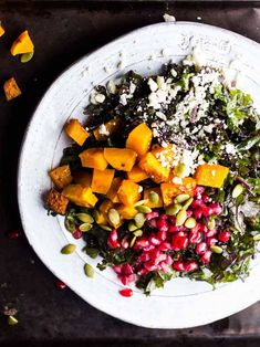 STYLECASTER | Winter Salads | Winter Salad Recipes | Harvest Kale Salad with Squash, Pomegranate, Feta, and Maple-Dijon Vinaigrette