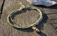 Turquoise Seed Beaded Seashell Charm Bracelet by cocolocca on Etsy