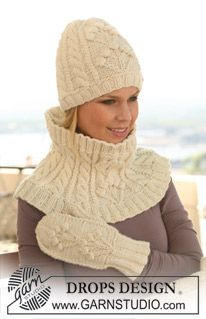 """Set comprises: Knitted DROPS hat and neck warmer with cables and textured pattern in """"Nepal"""". ~ DROPS Design"""