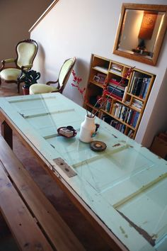Long desk (2 workstations) made from an old door with a glass top