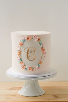 sweet buttercream cake with gold monogram | single tier cake of the cake trio, all white except C