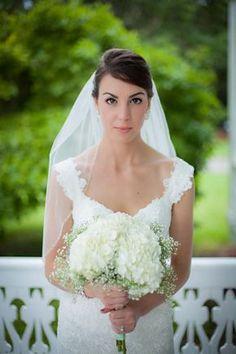 Top Ten Rustic Wedding Bouquet Recipes: Elegant babys breath and white hydrangea bouquet.