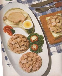 Pork Cut In Aspic (1963).  You apparently need an aspic mold shaped like a pork chop to create this.  Accompanied by additional pork chopped up and made into shiny little paperweight-like rounds, and (of course) radish roses.