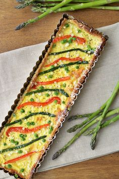 This vegetable tart is made with greek yogurt and fresh veggies. It's perfect for dinner with crusty French bread and an arugula sala...